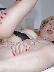 Horny granny gives a blowjob and gets her hairy twat slammed hardcore