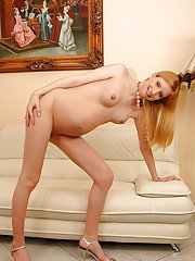 Pregnant teen babe on high heels stripping off her clothes