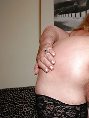 Fatty granny in nylon stockings stripping and rubbing her slit