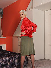 Well toned granny in nylon stockings slipping off her clothes