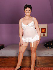 Filthy mature brunette uncovering her flabby tits and hairy cooter