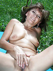 Naughty granny on high heels stripping off her dress and panties outdoor