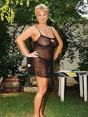 Curvaceous mature blonde uncovering her tempting body outdoor