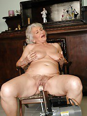 Mature big titted granny gets her pussy stretched with a machine