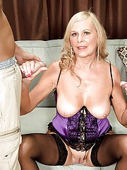 Busty granny Bethany James gives a blowjob while getting ass fucked