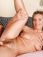 Lesbian babe with big tits fisting her MILF girlfriends hairy cunt