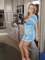 Lusty housewife Nikki Sexx takes off lingerie and teases her clit