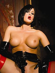 Busty brunette MILF Tory Lane stripping and toying her cunt
