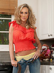 Graceful MILF with petite ass Brandi Love stripping in the kitchen