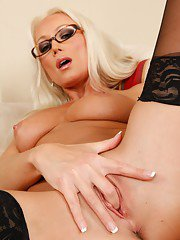 Seductive blonde babe in glasses Diana Doll stripping off her clothes