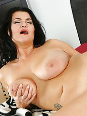 Fatty brunette MILF with massive jugs stripping and toying her pussy