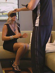 Voluptuous blonde babe gets blindfolded and gives a blowjob