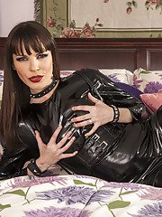 Hot MILF in latex outfit Dana DeArmond stripping and spreading her legs