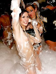 Adorable babes and horny guys are into hardcore foam sex party