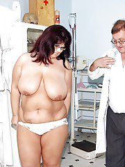 Fatty mature lady in glasses gets her cunt stretched and examed by gyno