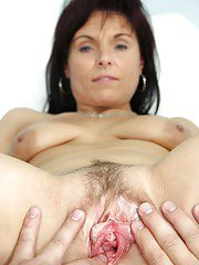 Mature brunette in stockings gets her nipples twisted by gyno
