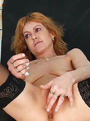 Redhead mature babe in stockings gets her twat examed and fingered by gyno