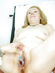 Mature blonde with ample ass gets her pussy examed by gyno