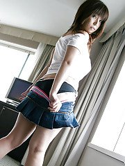 Seductive asian babe in miniskirt uncovering her tempting curves