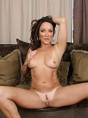 Graceful mature brunette Michelle Lay stripping and spreading her legs