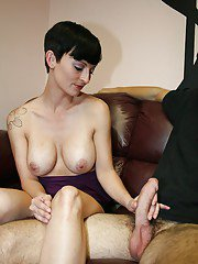 Short haired mature brunette with amazing tits gives a sensual handjob