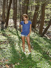 Ravishing teen babe Laney Rose stripping off her clothes outdoor