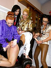 Fully clothed lesbians having fun with strapon and fake jizz