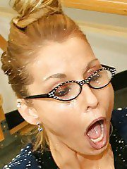 Big busted blonde MILF in glasses gets facial after handjob