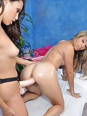 Graceful teen lesbian gets her tight pussy drilled by a strapon