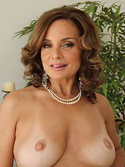 Hot mature lady Rebecca Bardoux taking off her dress and lingerie