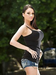 Pretty babe Celeste Star uncovering her gorgeous curves outdoor