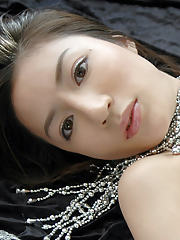 Adorable asian teen babe with long legs showcasing her graceful body