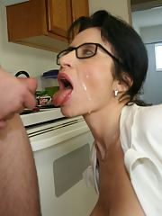 Naughty mature brunette in glasses gets a facial cumshot after a blowjob
