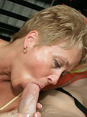 Short haired mature blonde sucking and jerking off a stiff prick