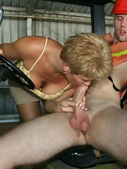 Short haired mature secretary sucking and jerking off a hard cock
