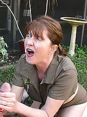 Lustful MILF in uniform gives a handjob and gets facialized outdoor