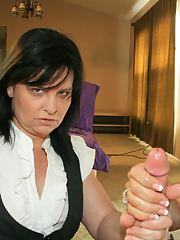 Filthy mature ladies take turns jerking off a big cock and share cumshot
