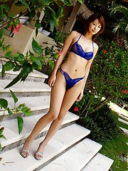 Seductive asian babe with tiny tits slipping off her blue lingerie