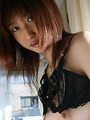Asian teen babe in stockings Mio Komori slipping off her shirt and lingerie