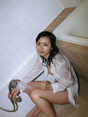 Petite asian babe with big tits and hairy pussy taking shower