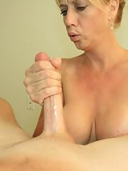 Lusty blonde MILF in glasses gives a blowjob and gets facialized