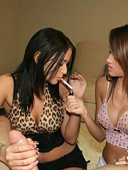 Smoking teen babes with petite tits showing off their handjob skills