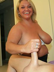Fatty mature lady with huge jugs sucking and jerking a big cock
