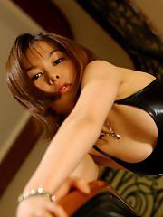Filthy asian babe with tiny tits posing in pantyhose and latex dress