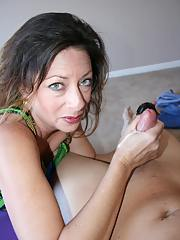 Lascivious fully clothed mature brunette strokong off a big cock