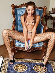 Adorable babe in fishnet pantyhose stripping and masturbating her slit