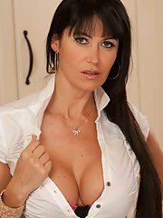Big busted MILF Eva Karera stripping off her suit and lingerie