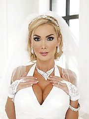 Alluring blonde bride slowly uncovering her gorgeous curves