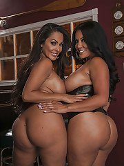 Curvaceous latina babes on high heels posing and stripping together