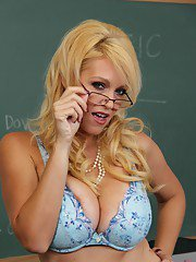 Mature lady in glasses Charlee Chase stripping off her suit and lingerie